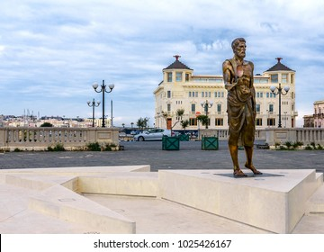 Syracuse, Sicily/Italy - January 28 2018: Archimedes Statue and Ortea Palace Luxury Hotel
