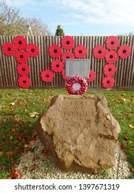 Syresham, Northamptonshire, England November 11th 2017. Lest We Forget. Village war memorial and poppy wreath seen on remembrance day