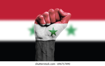 Syria flag painted on a clenched fist. Strength, Power, Protest concept