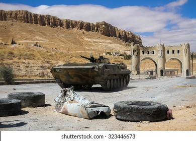 SYRIA, MAALULA - SEPTEMBER 2013. Fighting vehicle of the Syrian National Army leaves the gates of the city Ma'loula. Ma'loula became a place of fighting between Assad forces and the rebels.