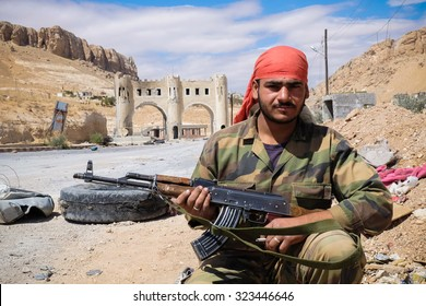 SYRIA, MAALULA - SEPTEMBER 2013. The soldier of the Syrian National Army at the gates of the city Ma'loula. Ma'loula became a place of fighting between Assad forces and the rebels.