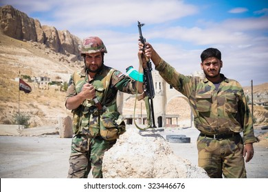 SYRIA, MAALULA - SEPTEMBER 2013. The soldiers of the Syrian National Army at the gates of the city Ma'loula. Ma'loula became a place of fighting between Assad forces and the rebels.