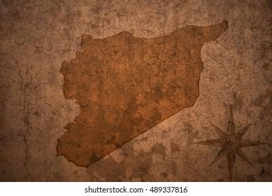 syria map on a old vintage crack paper background