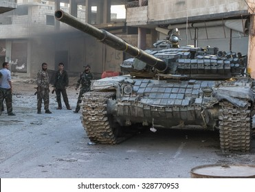 SYRIA, SHABAA, SEPTEMBER 2013. Syrian soldiers of the national army are near the tank after a battle with rebels in the suburbs of Damascus, Shabaa.