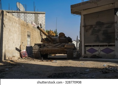 SYRIA, SHABAA, SEPTEMBER 2013. Tank Syrian national army stands between the buildings in the suburbs of Damascus, after the battles with rebels.