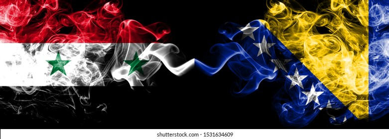 Syria vs Bosnia and Herzegovina, Bosnian smoke flags placed side by side. Thick colored silky smoke flags of Syrian and Bosnia and Herzegovina, Bosnian