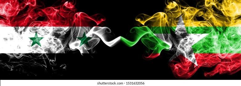 Syria vs Myanmar smoke flags placed side by side. Thick colored silky smoke flags of Syrian and Myanmar