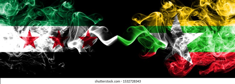 Syrian Arab Republic vs Myanmar smoke flags placed side by side. Thick colored silky smoke flags of Syria opposition and Myanmar