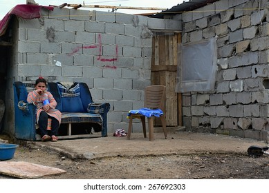 Syrian girl in front her house. She is illegal refugee in Turkey. 2.4.2015 Reyhanli, Turkey
