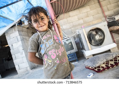 Syrian people in unofficial refugee camp in Akcakale. These people are refugees from Idlib, Rakka and Aleppo and escaped because of Syrian civil war. September 6, 2017, Akcakale, Turkey