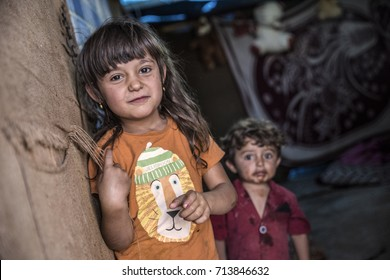 Syrian people in unofficial refugee camp in Reyhanli. These people are refugees from Idlib and escaped because of Syrian civil war. September 9, 2017, Reyhanli, Turkey