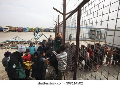 Syrian refugees who came from Aleppo waiting at the refugee camp in Essalame border gate on Turkey - Syria border in Essalame, Syria, 02 February 2016