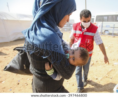 Syrian refugees who escaped from Kobane walking on Turkey-Syria border in Suruc. Sanliurfa, Turkey, 18 May 2014