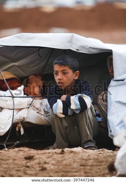 Syrian refugees who escaped from Kobane walking on Turkey-Syria border in Suruc. Sanliurfa, Turkey, 15 May 2014