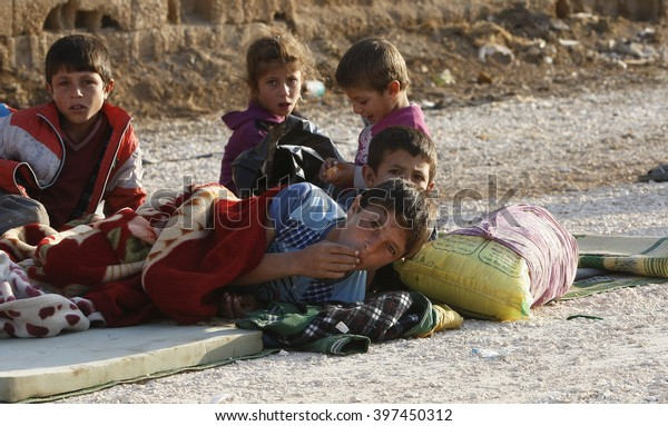 Syrian refugees who escaped from Kobane walking on Turkey-Syria border in Suruc. Sanliurfa, Turkey, 15 May 2104