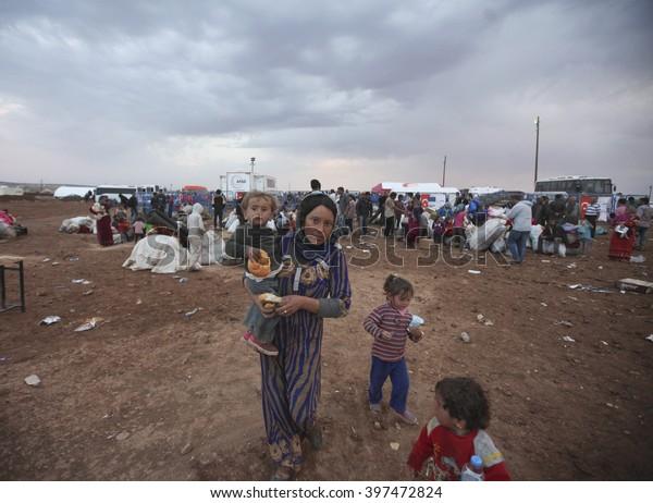 Syrian refugees who escaped from Kobane walking on Turkey-Syria border in Suruc. Sanliurfa, Turkey, 19 May 2014