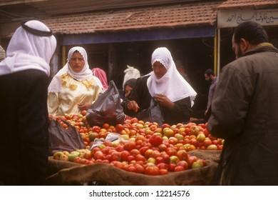Syrian street market, veiled arab women buying applesPalmyraSyria