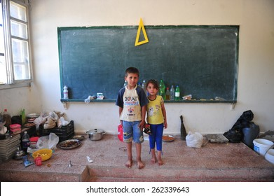 SYRIAN - TURKISH  BORDER -JUNE 10, 2012: unidentified Syrian people in refugee camp in Turkey on June 10, 2012 on the Syrian -Turkish border.