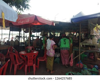 Syriem,Myanmar - 16 December, 2018 : The view of many people at the waterfront shop in front of the pier entrance leads to Midstream Kyauktan Pagoda, which is a respected place of Burmese.