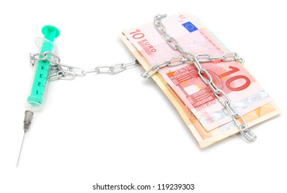 Syringe, chain and money. On a white background.