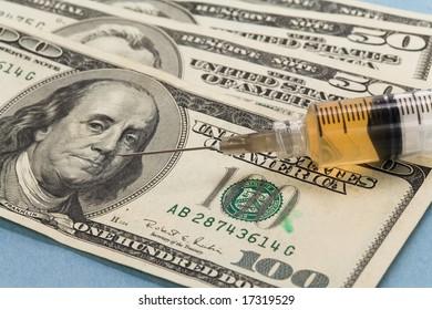 Syringe and dollar close up shot for background