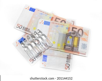 Syringe, drugs ampules. coins and twenty euro banknote isolated over white
