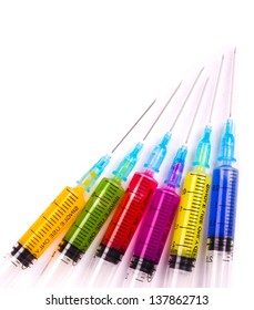 Syringe filled with solution various bright colors