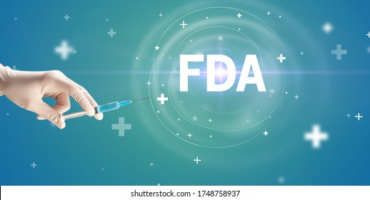 Syringe needle with virus vaccine and FDA abbreviation, antidote concept
