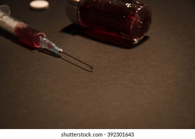 Syringe with red drop