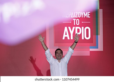 Syriza left-wing party leader and former Prime Minister Alexis Tsipras gestures as he delivers a pre-election speech to his supporters at Syntagma square in central Athens, Friday, Sept. 18, 2015.