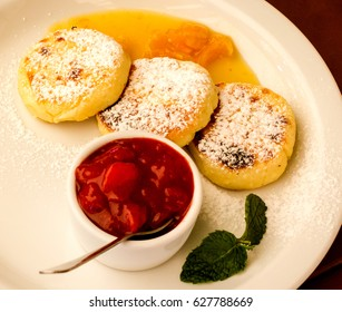 Syrnyky - ukrainian Cheese Pancakes for breakfast.