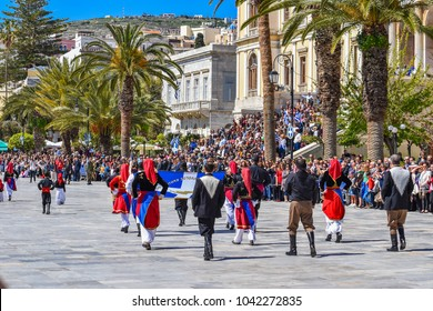 SYROS CYCLADES GREECE, 25 MARCH 2017: School students parade in groups in Syros island, Greece for the Greek National independence day. It is a major religious holiday with school and military parades