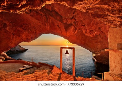 SYROS ISLAND, GREECE. Sunset at the cave of the church of Agios Stefanos, close to Galissas village.
