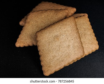 Syrup collars, a traditional Norwegian christmas biscuit isolated on black, sirupssnipper