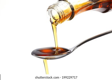 Syrup dripping off a spoon.