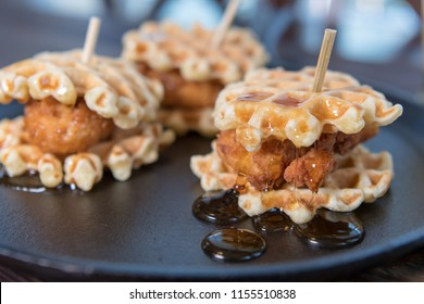 Syrup Pools Below Chicken and Waffle Sliders