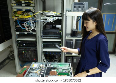 The system administrator works in the server room of the data center.