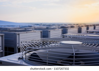 System of central compressor machine part of air conditioner system set on the roof of the roof building with sky background.
