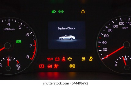 System check on engine start. Speedometer and tachometer with additional instruments on car dashboard.