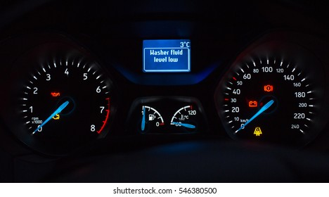 System check on engine start. Washer fluid level warning. Speedometer and tachometer with additional instruments on car dashboard.