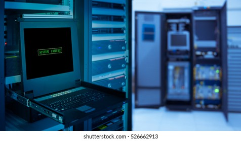 """ System failure "" and copyspace for text on monitor display in server room data center and blur rack server background."