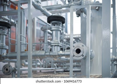 System of industrial cryogenic pipelines. A lot of pipes, flanges and valves. Abstract industrial background.