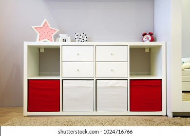 System for storage toys in children room. Safety storage system with soft boxes for children.