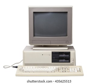 System unit with dual floppy disk drive, CRT monitor, keyboard, isolated on white background