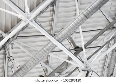 a system of ventilation pipes under stadium ceiling