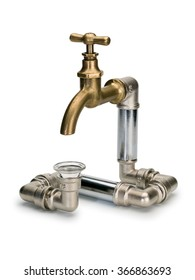 System of water pipes, brass faucet and a funnel from glass it is isolated on white