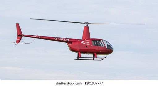 SYWELL, NORTHAMPTONSHIRE, UK – OCTOBER 7: Robinson R44 Cadet (G-CKZW) flying on October 7, 2018 Sywell Aerodrome, Northamptonshire, UK.
