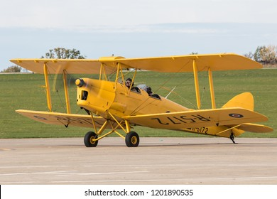 SYWELL, NORTHAMPTONSHIRE, UK – OCTOBER 7: De Havilland DH.82A Tiger Moth arriving on October 7, 2018 Sywell Aerodrome, Northamptonshire, UK.