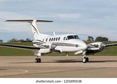 SYWELL, NORTHAMPTONSHIRE, UK – OCTOBER 7: Raytheon Aircraft Company Beech B200 Super KingAir (G-CIFE) moving on October 7, 2018 Sywell Aerodrome, Northamptonshire, UK.