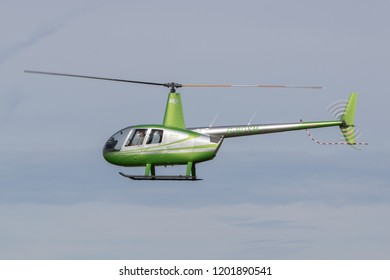 SYWELL, NORTHAMPTONSHIRE, UK – OCTOBER 7: Robinson R44 Raven II (G-ROYM) flying on October 7, 2018 Sywell Aerodrome, Northamptonshire, UK.